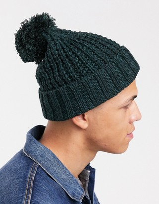 Asos Design DESIGN bobble beanie in chunky knit in bottle green and black twist