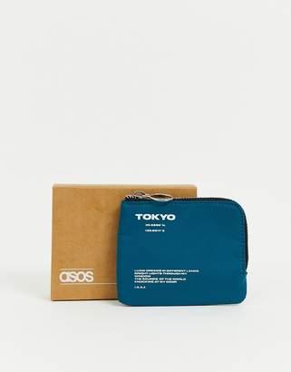 Asos Design DESIGN zip around wallet with white text detail in blue