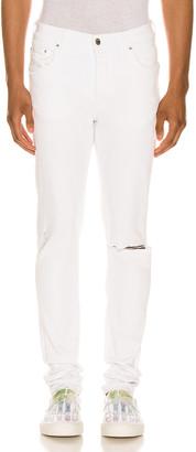 Amiri Slit Knee Jean in White | FWRD