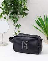 Asos Design ASOS DESIGN personalised faux leather wash bag in black with 'M' initial