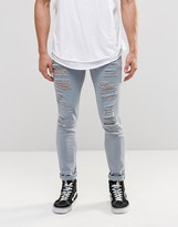Asos Super Skinny Jeans With Extreme Rips In Light Blue