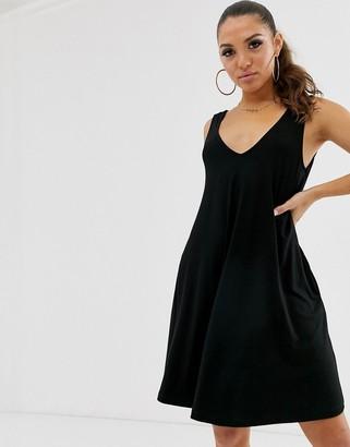 Asos Design DESIGN ultimate swing dress with concealed pockets-Black