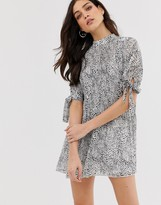 Asos Design DESIGN pleated trapeze mini dress with tie sleeves in splodge print