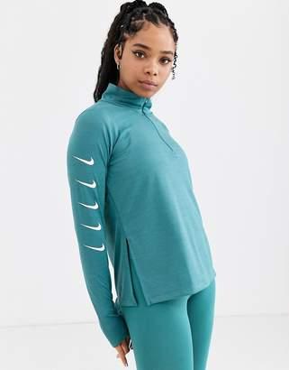 Nike Running swoosh half zip top in teal blue