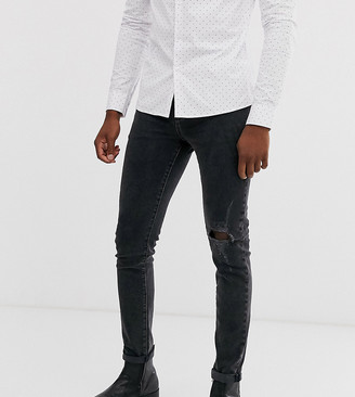 Asos Design DESIGN Tall 12.5oz skinny jeans in washed black with knee rip and destroyed hem