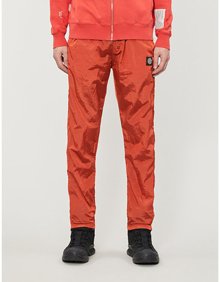 Stone Island Woven-pattern tapered shell trousers