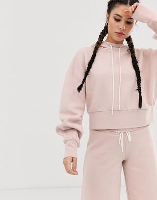 Reebok crop hoodie in pink