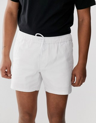 Asos Design DESIGN slim shorter chino shorts with elastic waist in white