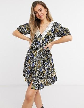 ASOS DESIGN button through mini smock dress with crochet peter pan collar in micro-floral print