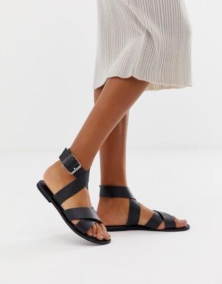 Flossy Asos Design ASOS DESIGN leather cross strap flat sandals-Black