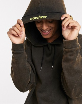 Asos Design DESIGN oversized hoodie in black with wash and text hood print