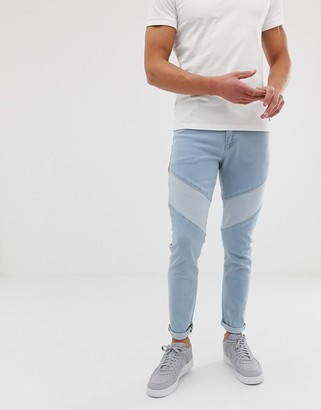 Asos Design DESIGN skinny jeans in light wash blue cut and sew panelling