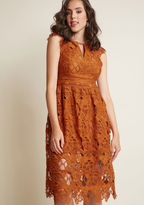 BC6145 Lean into your ladylike loveliness by flaunting this statement-making midi dress! Details like a flower-filled, crocheted lace overlay, fancy cap sleeves, and a neckline keyhole create feminine momentum in this harvest orange piece, while sheer peeks at t
