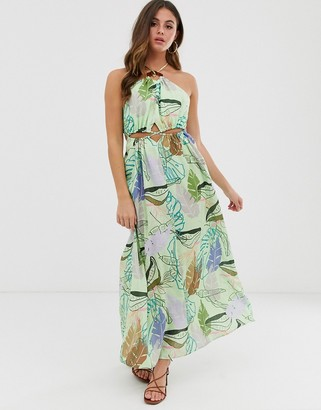 Asos DESIGN halter neck cut out maxi dress with trim detail in tropical print