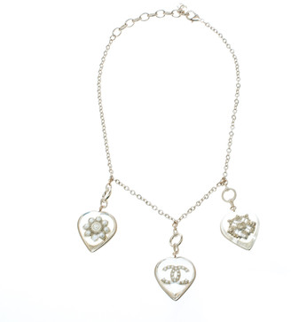 Chanel CC Aged Gold Tone Metal Motif Embedded Resin Heart Pendants Necklace