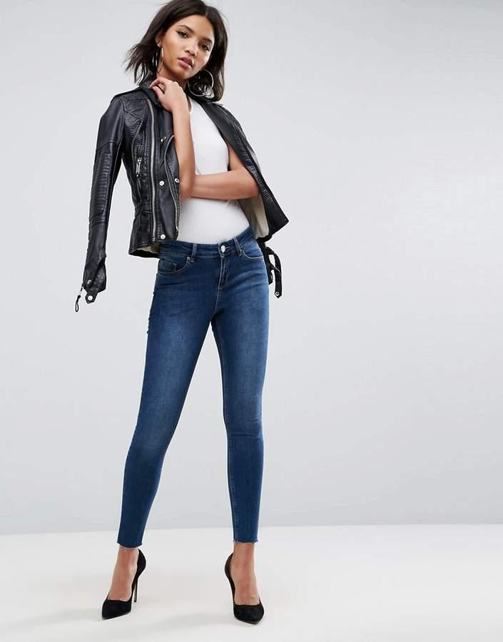 Asos Design DESIGN Lisbon midrise skinny jeans in kyla wash with raw hem