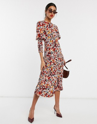 NEVER FULLY DRESSED long sleeve pleated skirt maxi dress in orange floral print