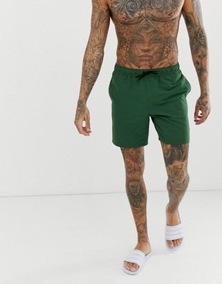 Asos Design DESIGN swim shorts in dark green mid length