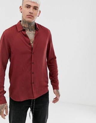 Asos DESIGN regular fit viscose shirt in rust