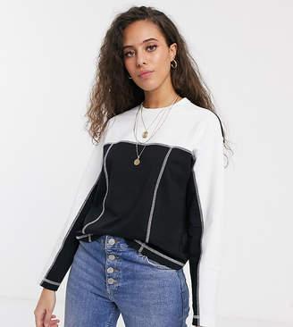 Asos DESIGN Petite sweatshirt in color block with flat lock seams-Black