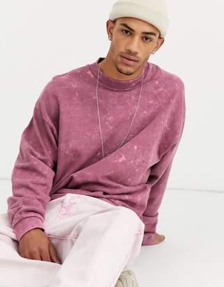 Asos Design DESIGN oversized sweatshirt with wash in purple
