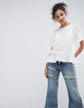 ASOS DESIGN woven t-shirt with ruffle hem