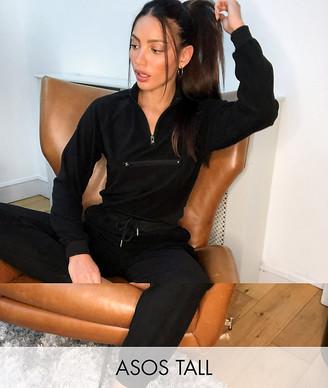 Asos Tall ASOS DESIGN Tall fleece tracksuit set; with half-zip top and slim sweatpants in black