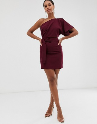 Vesper one shoulder mini dress with cut out and tie detail in rasberry