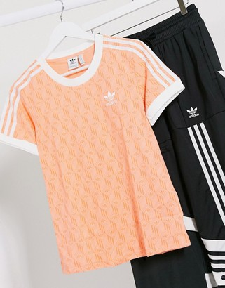 adidas logo three stripe t-shirt in coral