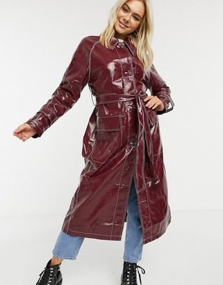 ASOS DESIGN vinyl trench coat with contrast stitching in oxblood