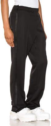 Maison Margiela Trousers in Black | FWRD