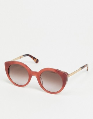 Kate Spade round sunglasses in pink with tortoise shell tips