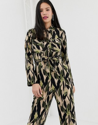 Monki utility boilersuit with oversized pockets and camo print in green