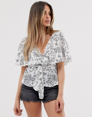 Asos Design DESIGN short sleeve sheer wrap top with cape detail in floral print