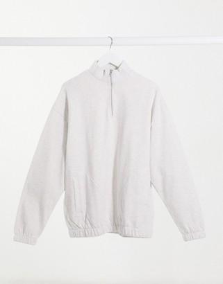 ASOS DESIGN organic oversized sweatshirt with half zip funnel neck in beige marl