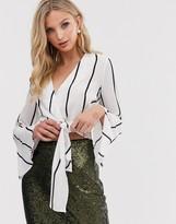 AX Paris wrap over flared sleeve blouse