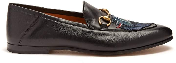 Gucci Brixton wolf-appliqué leather loafers