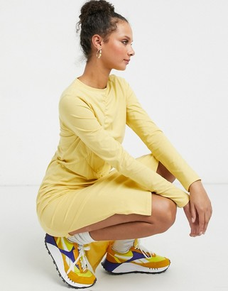 Monki Charla organic cotton long sleeve ruched front midi dress in yellow