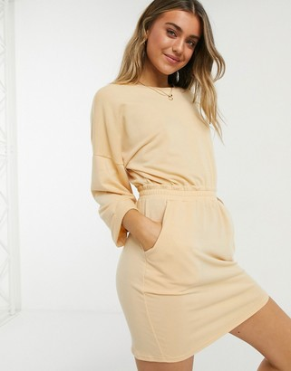 ASOS DESIGN mini sweat dress with waist band and rolled sleeve in buttermilk