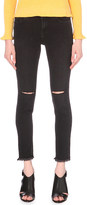 Mo&Co. Distressed skinny mid-rise jeans