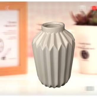 Creative Motion Ceramic Flower Vase in White;Product Size: 4x4x6. Desk Top Table Top center piece with flower in the vase decor any event party wedding home office