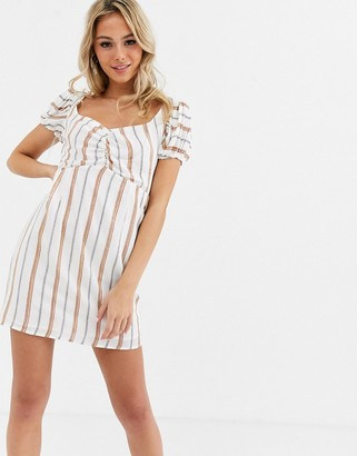 Glamorous mini dress with sweetheart neckline in stripe