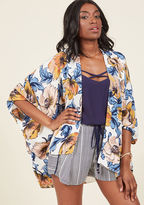 T11021AM With the draping of this white kimono over your outfit, you're ready to hit the sidewalk, shoreline, or soiree in effortless style! Breezy lapels, dolman sleeves, and a painterly floral print in marigold, ice blue, and pale pink equip this lovable layer w