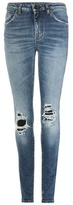 Saint Laurent Distressed skinny jeans with leather