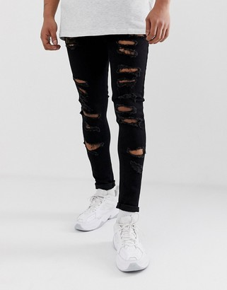 ASOS DESIGN spray on jeans in power stretch with heavy rips in black