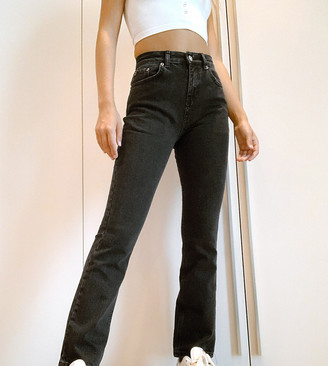 ASOS DESIGN Petite high rise '70's' kick flare jeans in washed black