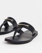 Asos Design DESIGN flip flops with gold brooch detail