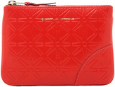 Comme des Garcons Star Embossed Small Pouch in Orange,Geometric Print.