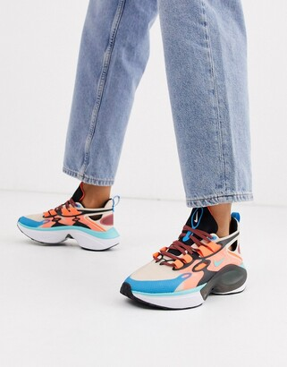 Nike Signal Sneakers in orange and blue