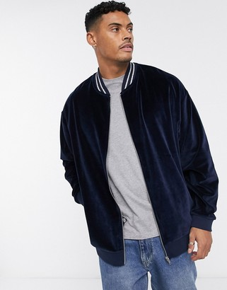 Asos Design DESIGN oversized bomber jacket in velour with silver stripe tipping-Navy